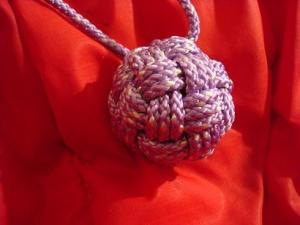"Variation on ABOK #2217 with 3 bights. In 5/32"" poly cord on 1.25\"" wood ball"